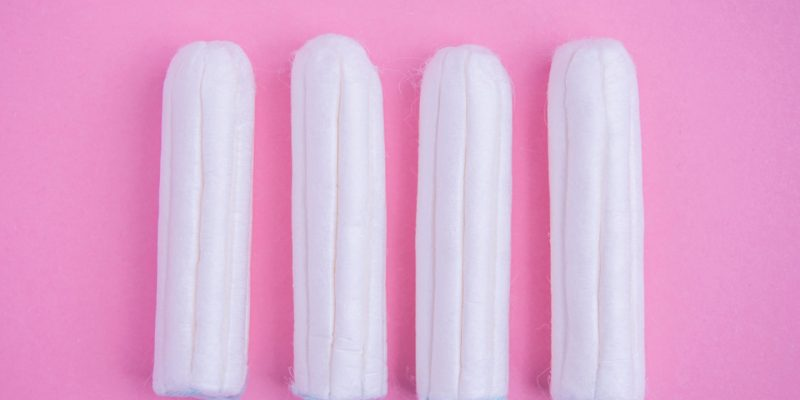 Tampons on pink background